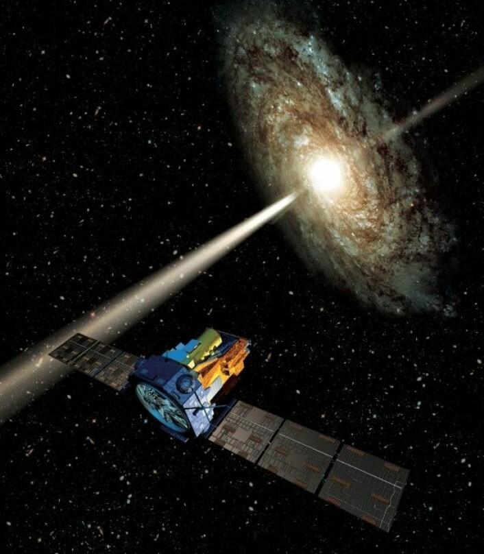 ESAs romteleskop Integral ser universet i røntgenstråling, som her et gammaglimt fra et svart hull i sentrum av en galakse. ESA/ATG medialab