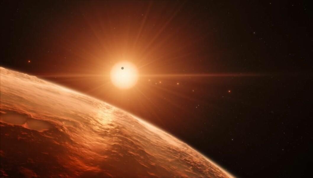 De ytterste planetene rundt stjernen TRAPPIST-1 kan holde på en atmosfære i milliarder av år.  (Illustrasjon: ESO/N. Bartmann/spaceengine.org)