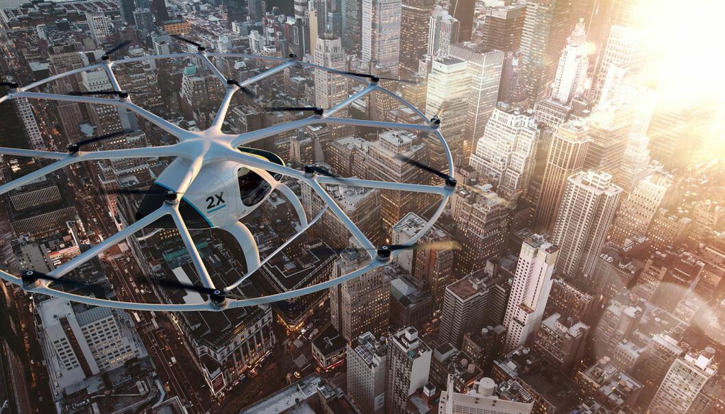 Transportselskapet Uber er med på planene om skytteltrafikk med det elektriske helikopteret Volocopter under verdensutstillingen i Dubai i 2020. Prøvedrift skal starte med myndighetenes velsignelse allerede i slutten av 2017, ifølge den tyske produsenten. (Illustrasjon: Volocopter)