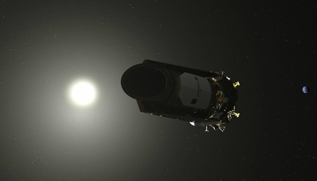 En illustrasjon fra NASA viser romteleskopet Kepler, som er tom for drivstoff. Oppdraget er dermed over for planetjegeren som har vært i virksomhet siden 2009. (Illustrasjon: AP / NTB scanpix)