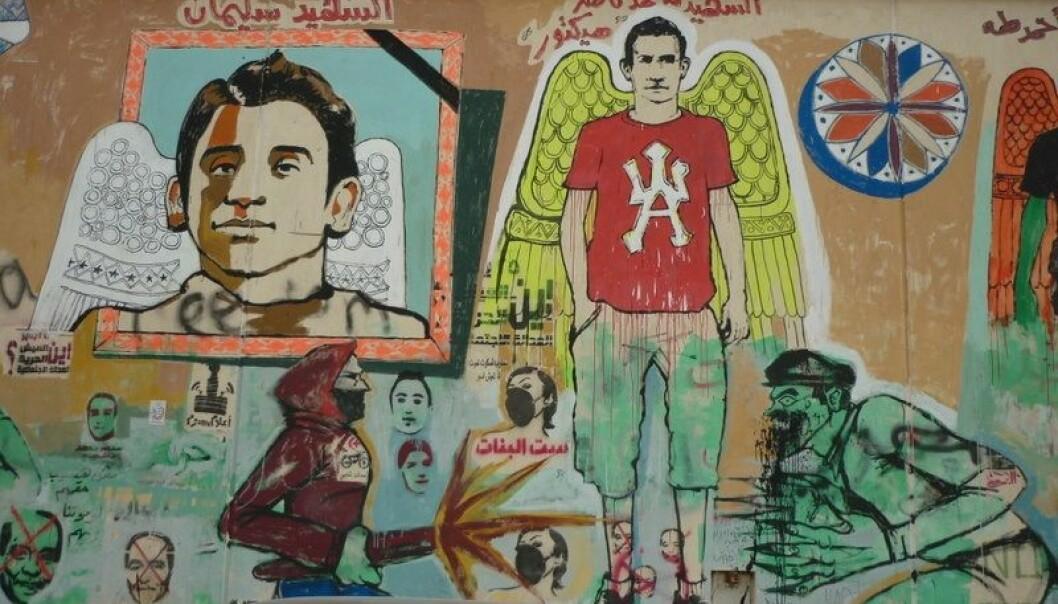 Bilder av de som døde under opprørene sirkulerte i sosiale medier og ble malt opp på vegger av gatekunstnere som symboler på uskyldige ofre for myndighetenes brutalitet. (Foto: Mohamed El Dahshan/ flickr).