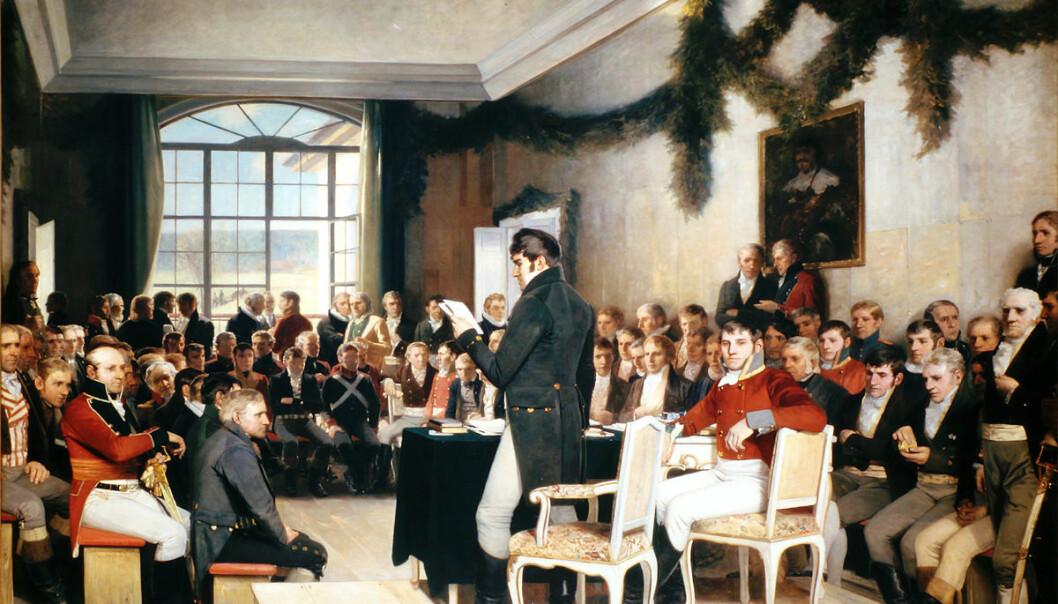 Det er den amerikanske og franske grunnloven som blåser inn i Rikssalen på Eidsvoll, mener kunsthistorikeren Eivind Torkjelsson. Det første utkastet av maleriet til Oscar Wergeland så ikke slik ut. Der er gardinene trukket for og vinduene lukket. (Bilde: Maleri av Oscar Wergeland, fotografert av Erlend Bjørtvedt (CC-BY-SA))
