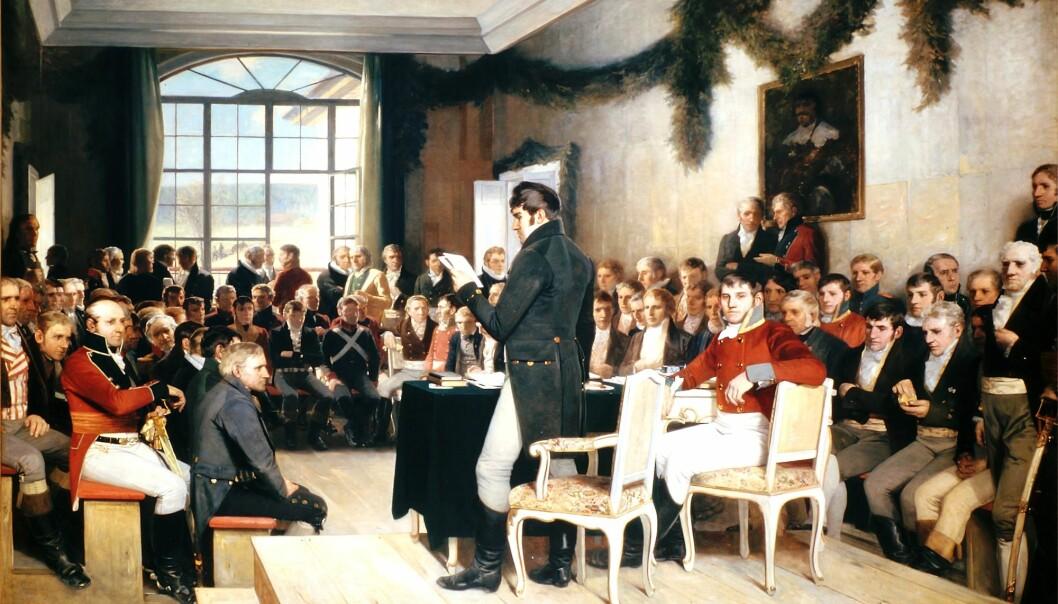 Norge var et land i økonomisk kaos da Grunnloven ble vedtatt i 1814. De første stortingsrepresentantene våre sto overfor vanskelige valg. De ble enige om å tvinge nordmenn til å gi fra seg arvesølvet sitt – for å kunne etablere Norges Bank. Under arbeidet med en ny doktorgrad er forskeren blitt slått av hvor ærlig politikerne våre opptrådte den gangen. Bildet viser Riksforsamlingen på Eidsvoll i 1814.  (Maleriet er av Oscar Arnold Wergeland)