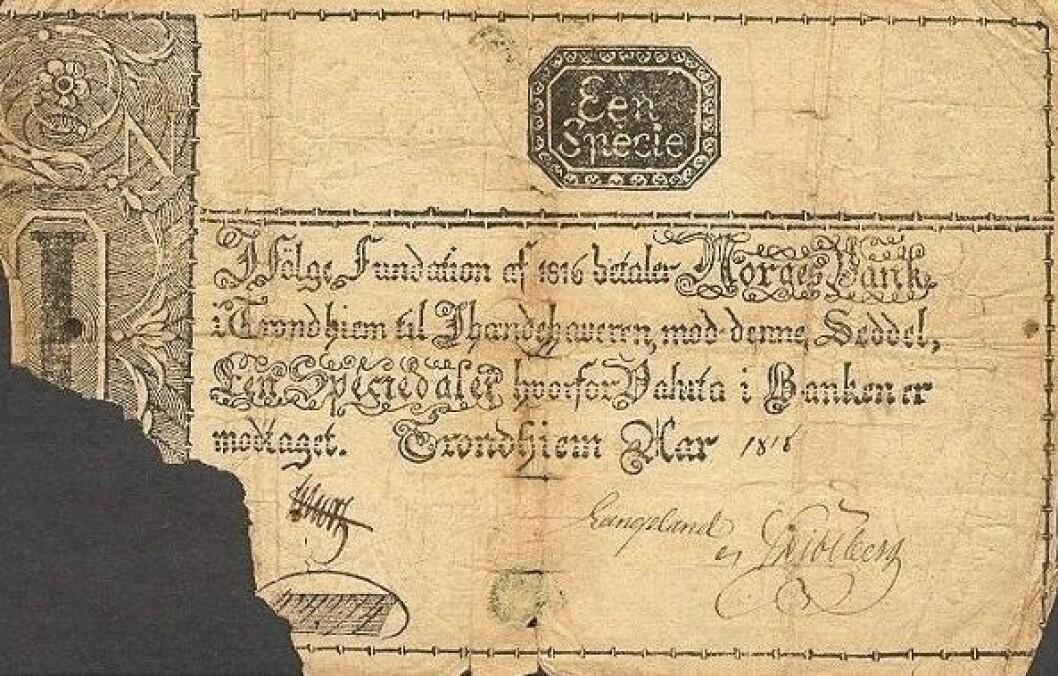 Slik så de første norske pengesedlene ut. 1 speciedaler utgitt av Norges Bank i Trondheim i 1818.