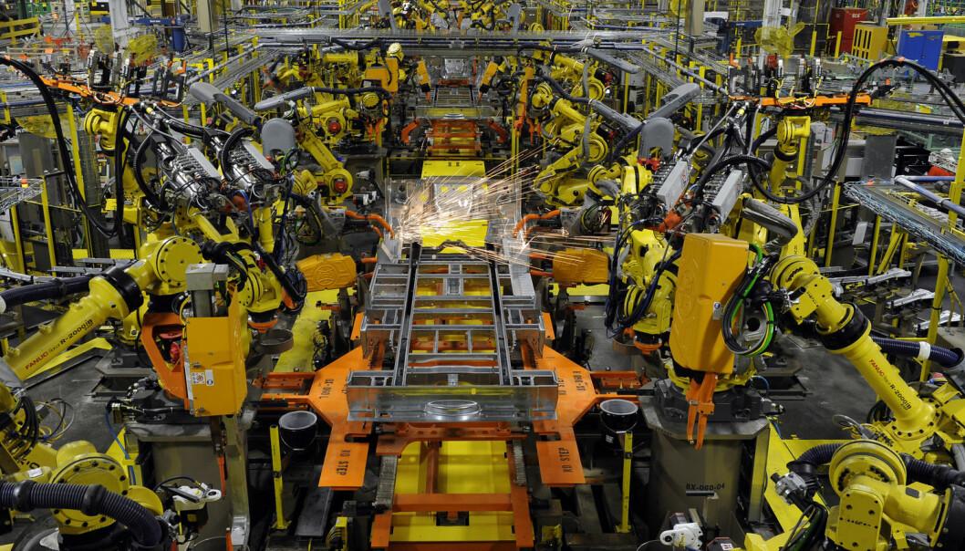 Industriroboter i arbeid på en Ford-fabrikk i Missouri.  (Foto: Dave Kaup / NTB scanpix)
