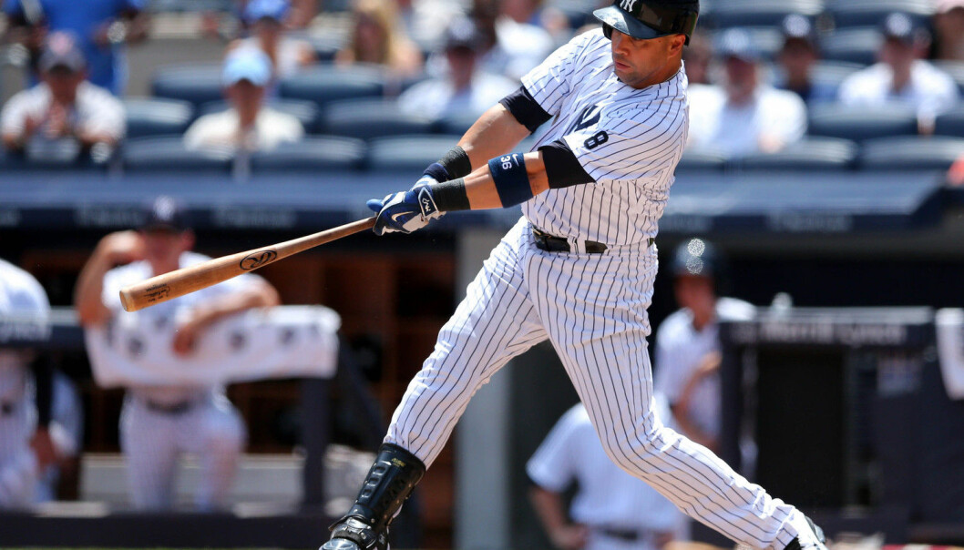 Carlos Beltran slår en home run og hjelper hjemmelaget New York Yankees til seier over San Francisco Giants i fjor sommer. (Foto: Brad Penner, Reuters/NTB scanpix)