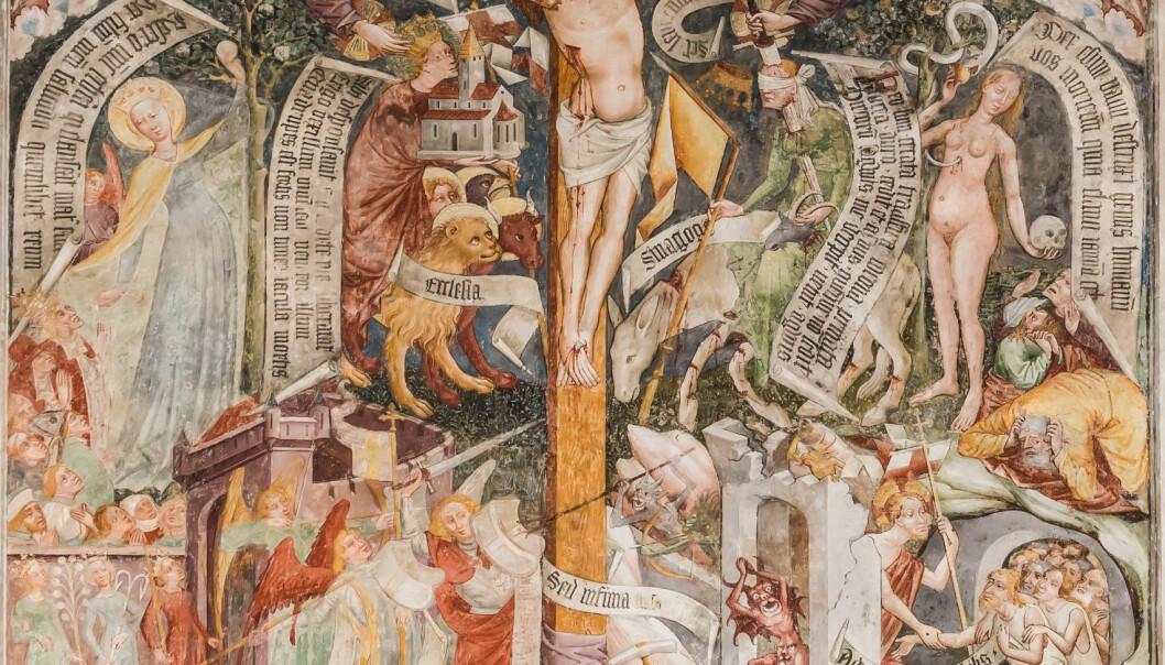 Utsnitt av maleri i Andreaskirken i Thörl-Maglern-Greuth, Østerrike. Motivet viser en korsarm som velsigner kirken (ecclesia), og den andre som dreper synagogen (sinagoga). Kirken er representert ved en mann som bærer kirken og krones med en kongekrone. Synagogen vises som en kvinne med bind for øynene, gjennomboret av et sverd. (Foto: Johann Jaritz/Wikimedia Commons CC BY-SA 3.0 AT)