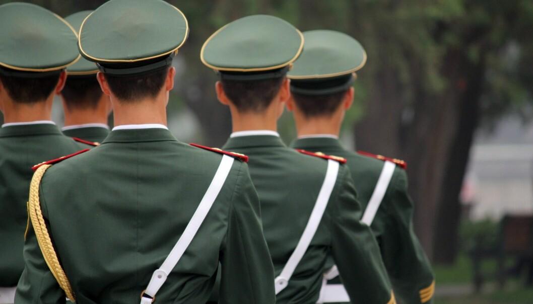 Kinesiske soldater marsjerer på Den himmelske freds plass i Beijing. (Foto: ChadwickWrites / Shutterstock / NTB scanpix)