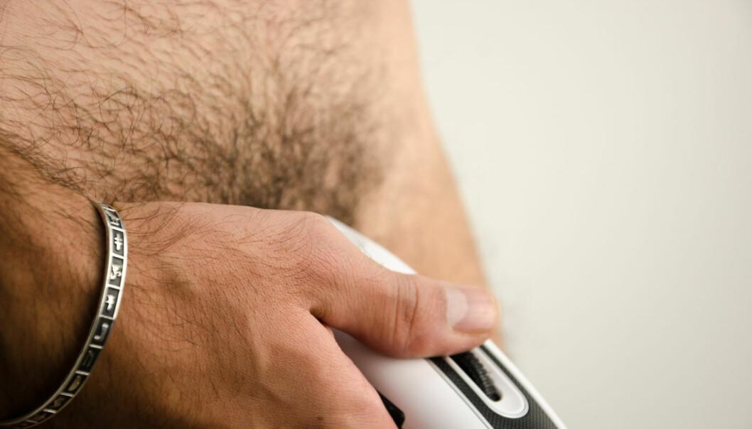 Menn bruker oftest barbermaskin når de fjerner kjønnshår. (Foto: Shutterstock/NTB scanpix)