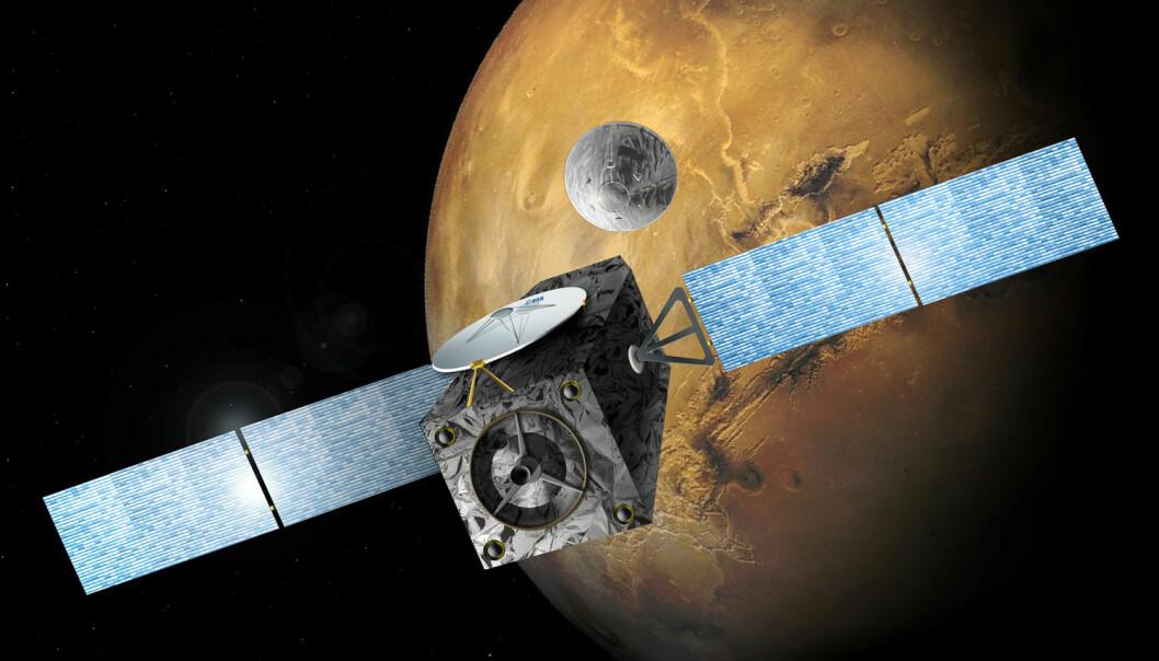 En illustrasjon laget av ESA viser Mars-sonden Trace Gas Orbiter (TGO) og landingsfartøyet Schiaparelli like etter at de to er koblet fra hverandre.  (Foto: Handout / Reuters / NTB scanpix)