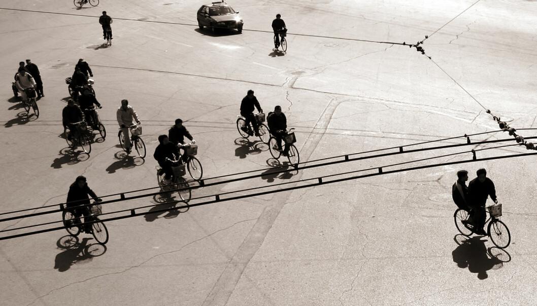Sykler har nesten forsvunnet fra bybildet i mange kinesiske byer. Bildet er fra Beijing i 2006. (Foto: Shutterstock / NTB scanpix)