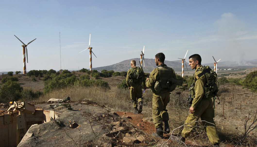 Israelske soldater patruljerer nær den syriske grensen på Golanhøydene. Det israelske oljefirmaet Afek har gjort prøveboringer på området siden 2015. (Foto: Nir Elia/NTB scanpix)