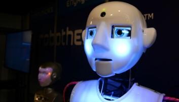 Faktaorienterte journalister kan lettere bli erstattet av en robot enn en snekker og sykepleier. Det mener professorer ved NTNU som er intervjuet i denne podcasten. (Foto: AFP photo, Eric Piermont, NTB scanpix)