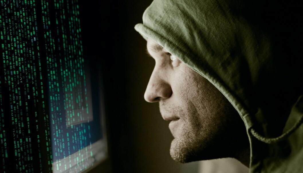 Ved hjelp av datateknologi kan en liten datakyndig gruppe i dag utføre kriminelle handlinger av store dimensjoner. (Illustrasjonsfoto: Colourbox)