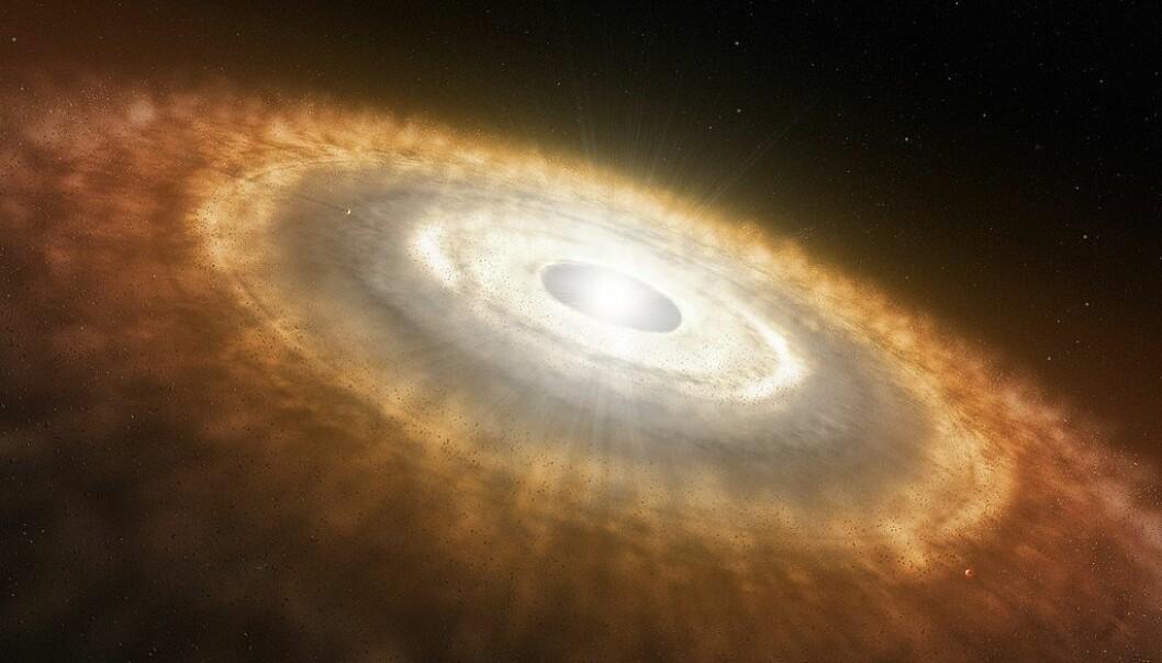 Sånn kan det ha sett ut i solsystemets spede begynnelse, da støv og is så smått begynte å danne planeter. Kan noen DNA-byggeklosser ha blitt til på denne tiden? (Bilde: ESP/L.Calcada/CC BY 4.0)