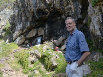 Professor Christopher Henshilwood outside Blombos Cave in South Africa, where his work combines excavations with climate simulations better to understand human history. (Photo: TRACSYMBOLS)