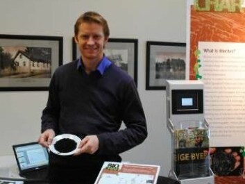 Biochar has many benefits, some of which may prove important for a more climate friendly agriculture in future. Researcher Adam O'Toole is shown next to the Biochar stand at the Bioforsk conference earlier this year. (Photo: Kathrine Torday Gulden)