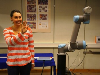 Signe Moe's task has been to find out how a robot can be trained to imitate human movements. She has solved this using a system by which she guides the robot using a Kinect camera typically used in games technology. (Photo: Morten Gunnerud)