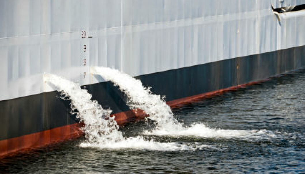 A ship pumps out ballast water when taking on cargo. (Photo: iStockphoto)