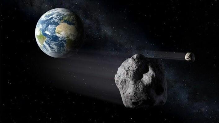 Asteroiden som fløy forbi Jorda på søndag var like bred som et passasjerfly. Her er asteroiden illustrert idet den farer forbi planeten vår. (Foto: ESA- P. Carill)