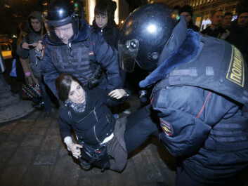 Pussy Riot member Tolokonnikova is detained by police at a protest in central Moscow. (Photo: Maxim Shemetov, Reuters)