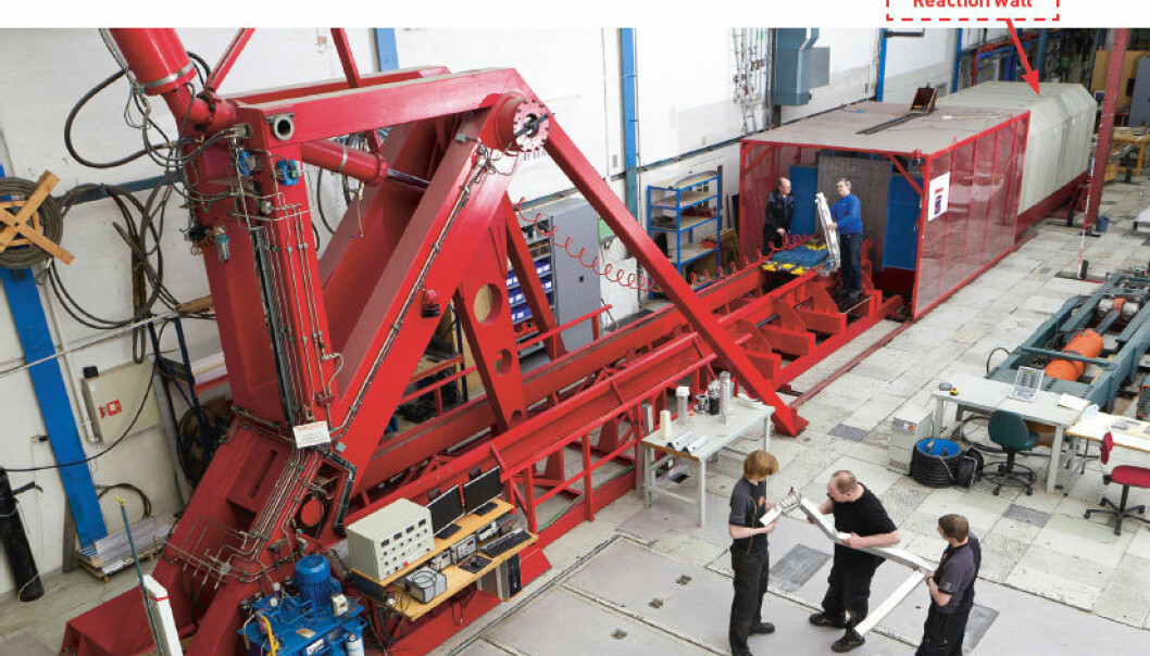 """The two-storey bright red """"Kicking Machine"""" is so powerful it needs a 150,000 tonne reaction wall behind it to absorb the force of its blow. (Photo. SIMLab)"""