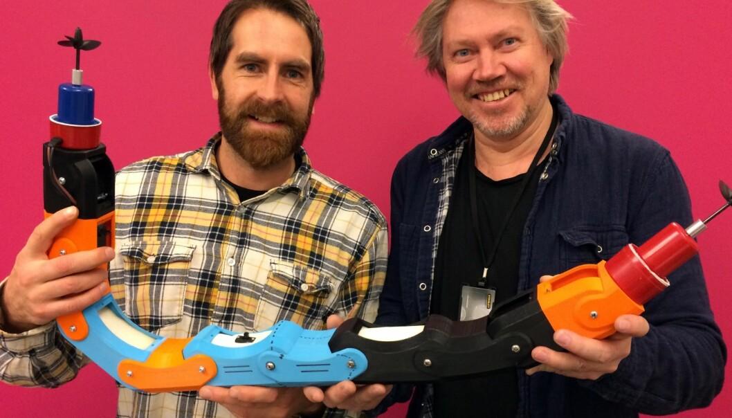 SINTEF-scientist Gorm Johansen (right) and Fredrik Lund from Inventas with the new robot. (Photo: Inventas)
