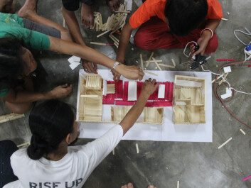 Involving the future residents of the housing project is an important part of the development process. Here, the children in Streetlight help build models of the houses that are being rebuilt— the ones that they are going to live in. (Photo: Workshop/NTNU)