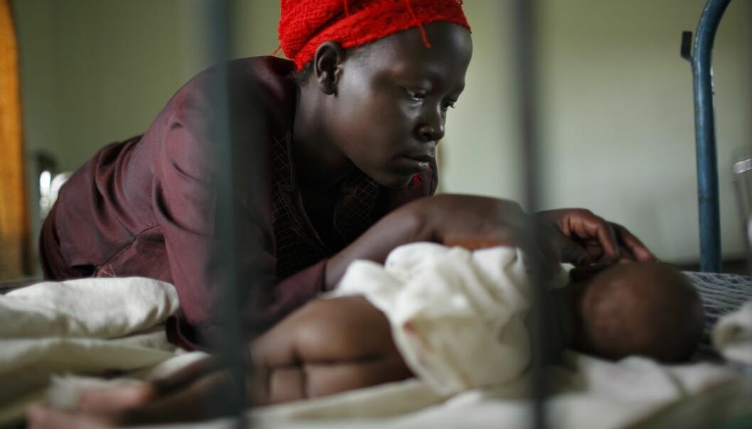 Mor og barn, begge hiv-smittede, i Kangulumira, Uganda. (Foto: Tomas Van Houtryve, Corbis)
