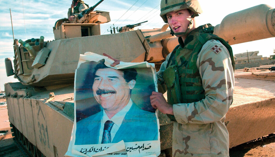 An American soldier holds up a poster with the deposed Iraqi president Saddam Hussein in 2003. The US Army Research Lab points out that the new, mathematical logic that has been developed at UiO may improve American intelligence operations. (Photo: Scanpix)