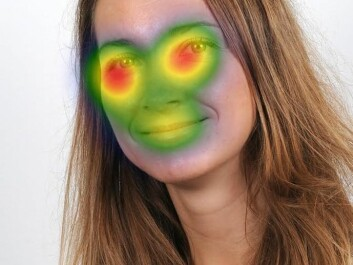 The areas we typically scan when viewing a face for several seconds. The red areas show what we look at most, with colors gradually changing to blue for the areas that receive less attention. Here, a picture of the researcher herself - Olga Chelnokova. (Photo: Lasse Moer, UiO)