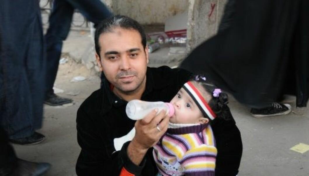 Man with bottle: Nurturing Masculinities. Picture taken by Nefissa Naguib, Cairo 2012