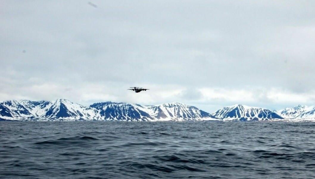 The FAAM research aircraft BAe 146 in the air over Prins Karls Forland on the west coast of Svalbard. (Photo: CAGE)
