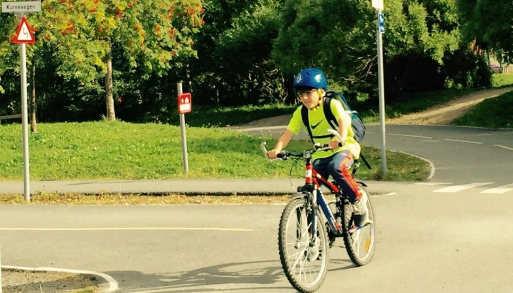 A boy taking a cycling test wearing glasses with installed sensors costing NOK 250,000 a pair. The results from this trial will help Norwegian children to get even better cycling instruction. (Photo: SINTEF)