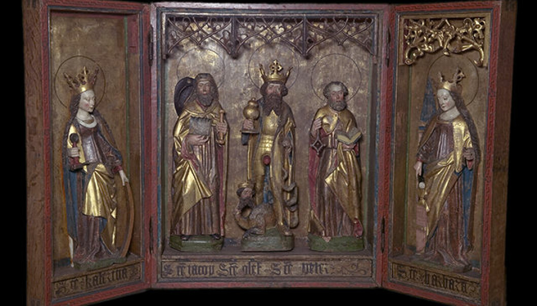 """""""The altarpieces were the most elevated elements in a church,"""" says Kristin Kausland. The inside of the case usually contains carved sculptures, while the inside of the doors can also have such sculptures or paintings. This altarpiece is from Kvæfjord church. (Photo: Museum of Cultural History)"""