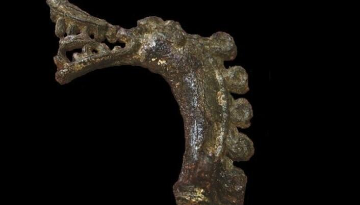 A tiny dragonhead illuminates life in a Viking trading town