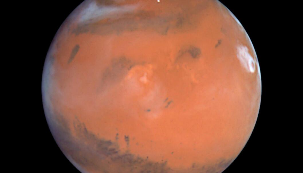 Et bilde av planeten Mars, tatt av romteleskopet Hubble i 1999. De som reiser dit, setter sin egen helse og hjerne på spill.  (Foto: Reuters/NASA/NTB scanpix)