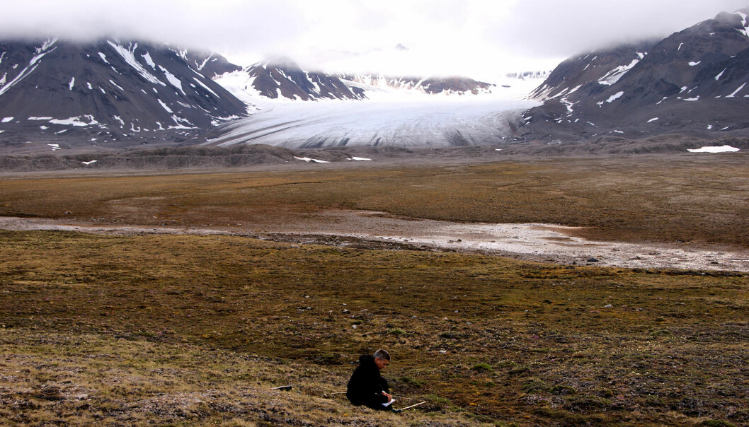 """""""Warmer winters on Svalbard are not tantamount to a greener landscape"""", says researcher by Jarle W. Bjerke. The image shows Bjerke doing fieldwork on Svalbard. (Photo: Trond Pedersen)"""