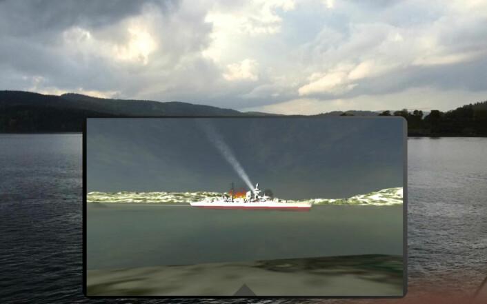 Når brukeren holder mobiltelefonen foran Drøbaksundet, vises samme scene på skjermen med krysseren Blücher ute på fjorden. Når skjermen vris, endres perspektivet tilsvarende. Dette kalles augmented reality (AR). (Foto: Gunnar Liestøl)
