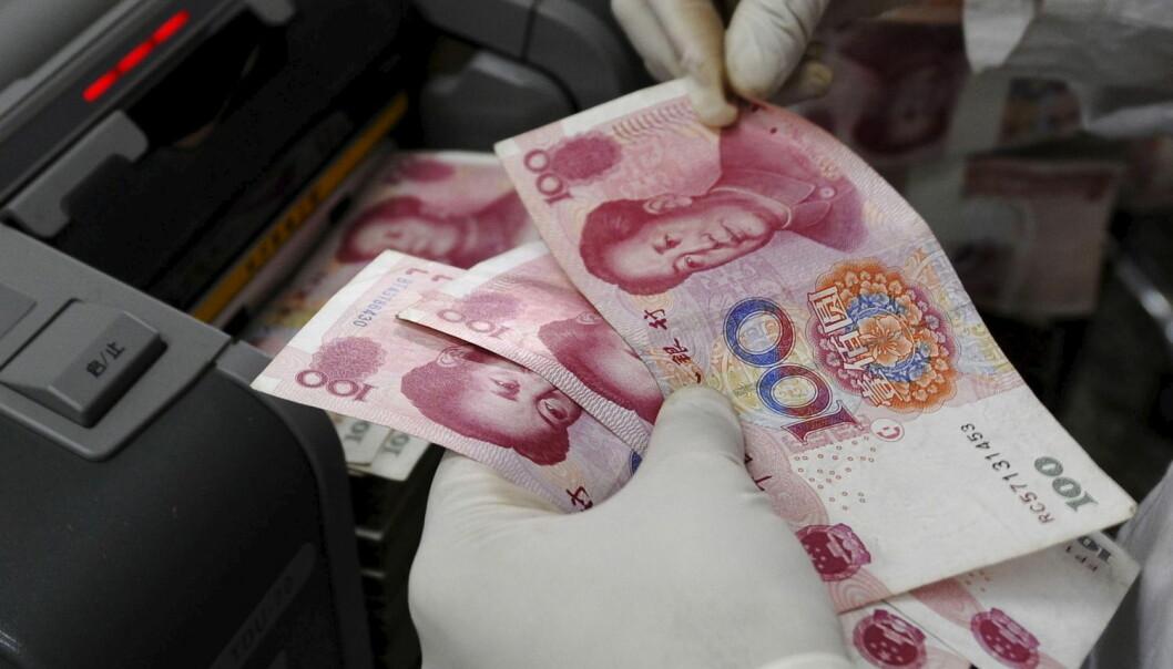 Økonomer verden over spekulerer i hva som er årsaken og hva som blir konsekvensene av en svekket yuan. – Dette er et tegn på at en æra i kinesisk økonomi er forbi, sier norsk økonomiprofessor. (Illustrasjonsfoto: Reuters)