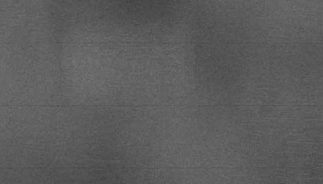 Ikke så lett å se uten de rette metodene, men denne grå massen er faktisk et satelittbilde av Tromsøya og områdene rundt.  (Illustrasjon: Yngvar Larssen, Norut)