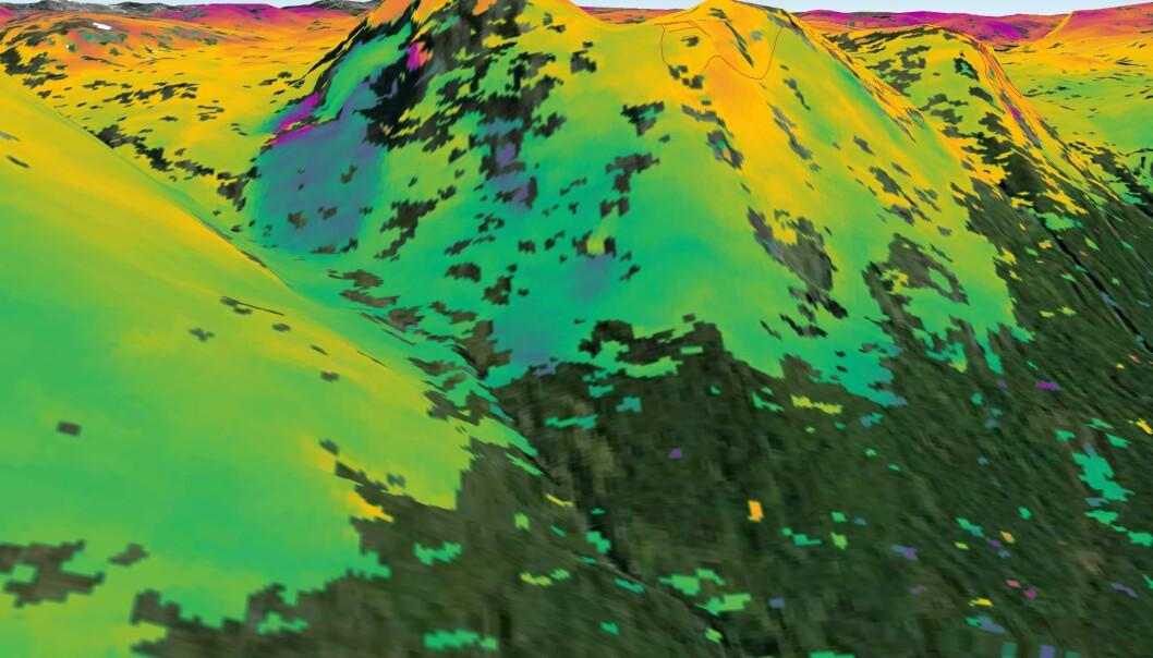 «SAR interferometry» kan brukes til å spå hvor det er risiko for jordskred - her i Kåfjord i Troms. Området på bildet er kjent som ustabilt. Sentinel-1A- radaren skannet området 23. september og 30. august 2014. Der bildet viser blå skygger langs fjellsiden, har underlaget beveget seg omtrent én centimeter i denne perioden. Norske myndigheter bruker teknikken over hele landet for å kunne beregne skredrisiko. (Foto: ESA)