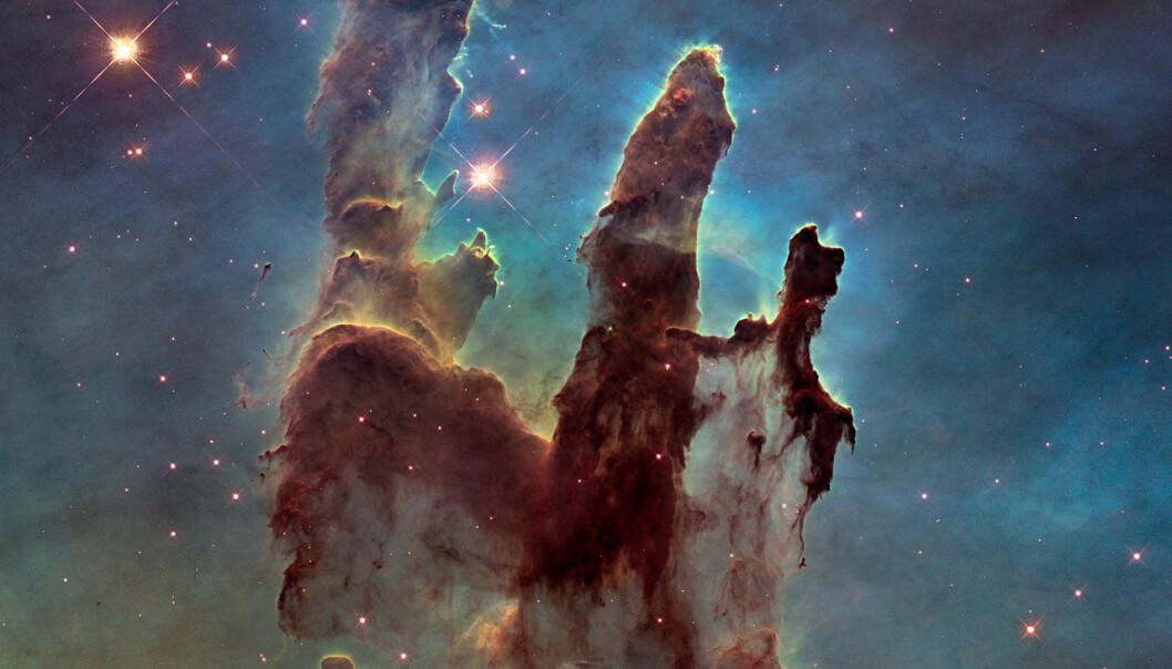 Gasspilarene slik Hubbles nyeste kamera ser dem. Dette bildet er tatt i det vanlige lysspekteret, samme som vi ser med våre øyne. (Foto: NASA, ESA/Hubble and the Hubble Heritage Team)