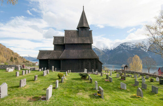 What do the animals in stave church ornamentation signify?