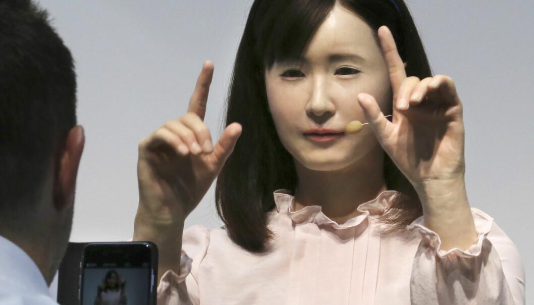 Prototypen på en robot fra firmaet Toshiba kommuniserer med tegnspråk på den japanske teknologiutstillingen CEATEC Japan, 7. oktober 2014. (Foto: Koji Sasahara/NTB Scanpix)