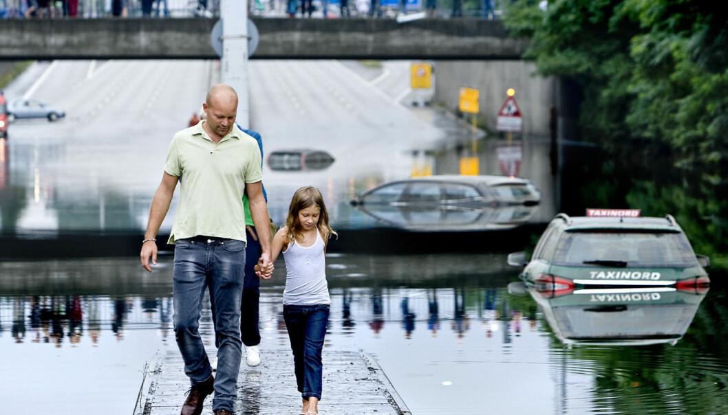 Natt til 31. august falt over 100 millimeter regn noen steder i København. (Foto: Bax Lindhardt, AFP Photo/NTB Scanpix)
