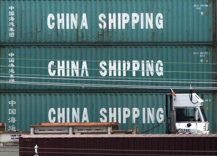 Hva koster handelskrigen Kina? Så langt er antakelig ikke Kinas økonomi blitt svekket med mer enn 1 prosentpoeng lavere vekst. Men skadevirkningen kan bli mye større. De kan vise seg i form av økt usikkerhet når det kommer til nye økonomiske investeringer. (Foto: Mark Ralston/AFP/NTB scanpix)