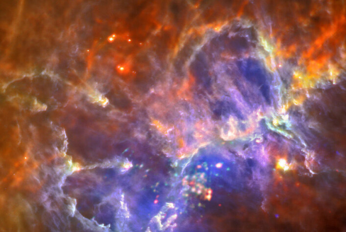 Et område med interstellart gass og støv i Melkeveien, tatt av romteleskopet Herschel. Her dannes nye stjerner. (Foto: ESA/Herschel/PACS/SPIRE/Hill, Motte, HOBYS Key Programme)