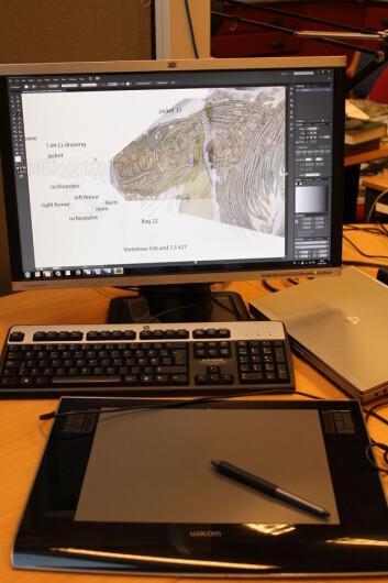 Doktorgradsstipendiat i arbeid! I det siste har jeg tegnet alle de fossile fiskeøglene jeg jobber med. Foto: LLD