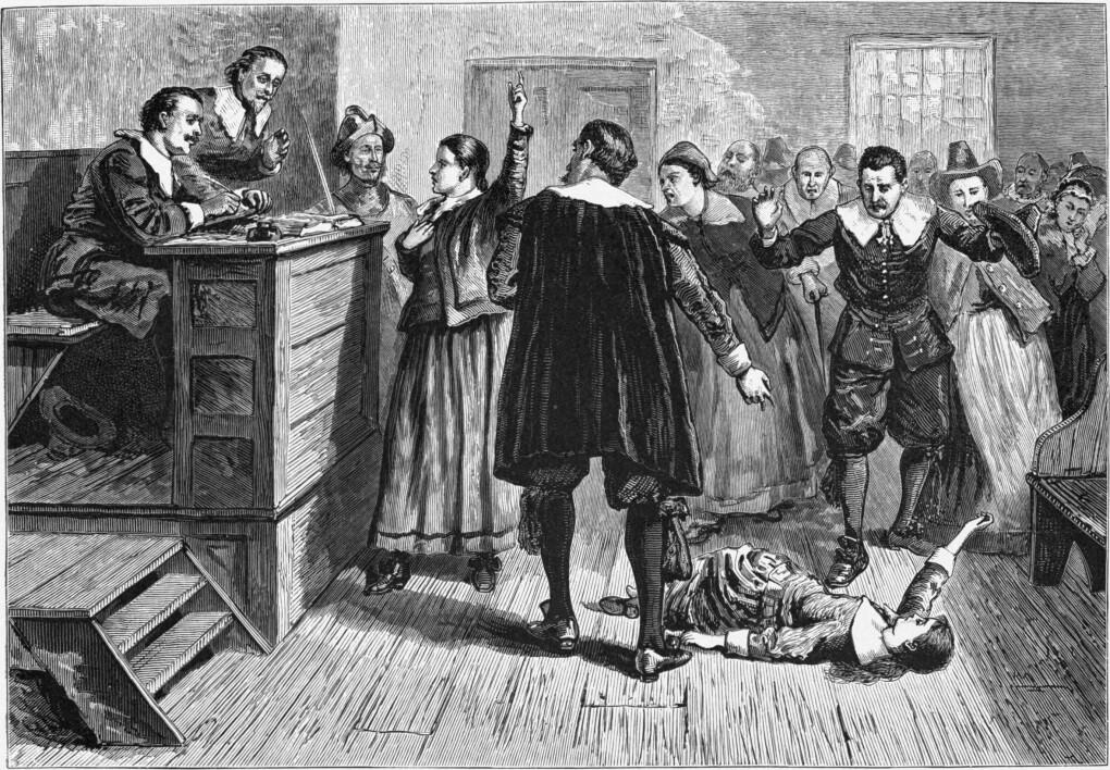 En illustrasjon fra hekseprosessene i Salem. Jenta på bakken er tilsynelatende påvirket av hekseri. (Illustrasjonsbilde: Wikimedia commons)